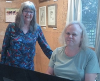 Cisgender Judy Kotai with Mx Margaret at piano 2015