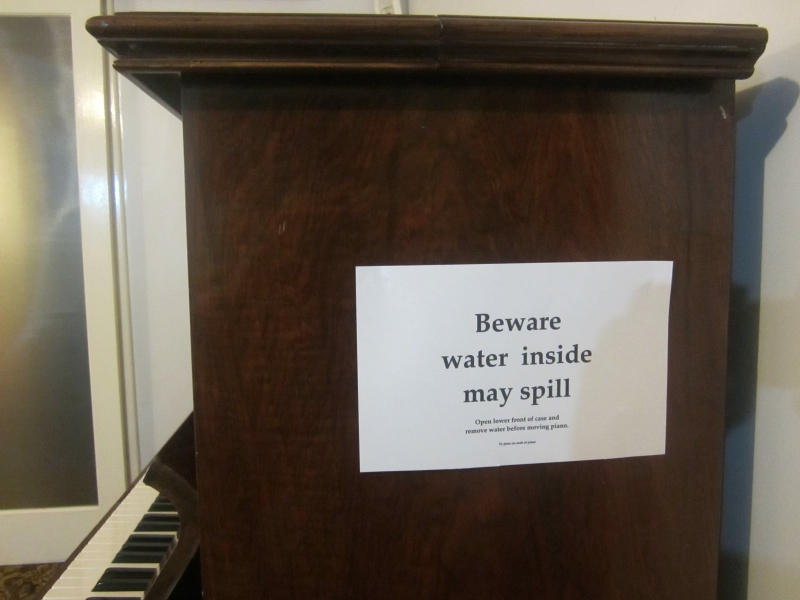 pp20130123.04-water-inside-may-spill-sign-on-piano72.jpg